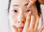 woman in her 30s or 40s putting in contact lens