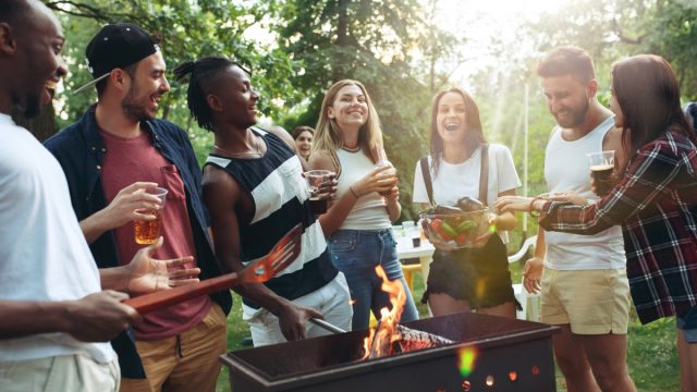 young friends grilling outdoors