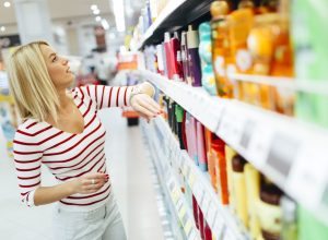 young woman shopping for personal care products at drugstore