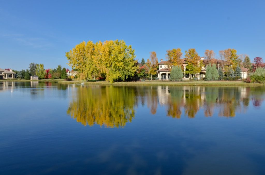 a lake, trees, and houses in Cherry Hills Village, Colorado
