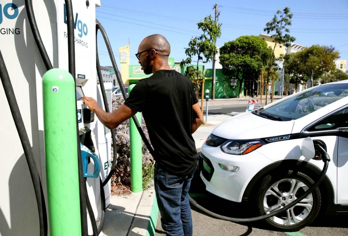Michael McDaniel, 30, of Bakersfield, completes his purchase after charging his 2019 Chevy Bolt rental at a charging station at the corner of Bay and Columbus in San Francisco, Calif., on Thursday, September 26, 2019. It took nearly an hour to charge his vehicle at the total of $6. (Photo By Yalonda M. James/The San Francisco Chronicle via Getty Images)