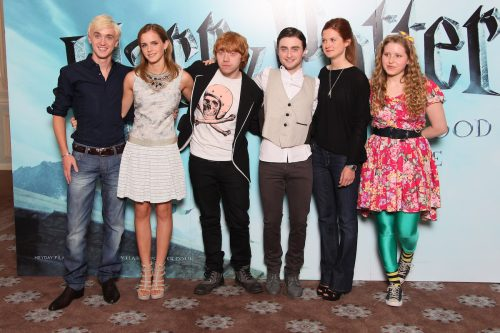 """Tom Felton, Emma Watson, Rupert Grint, Daniel Radcliffe, Bonnie Wright, and Jessie Cave at a photocall for """"Harry Potter and the Half-Blood Prince"""" in 2009"""