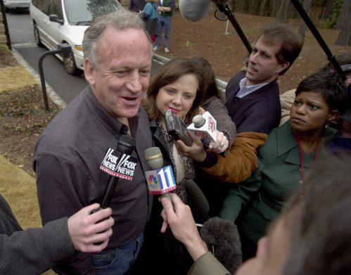JonBenet Ramsey's parents speaking to reporters in 2001 after their home was broken into