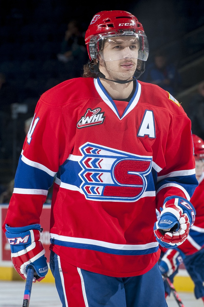 Liam Stewart in red hockey uniform