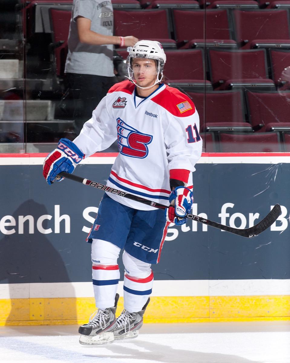 Liam Stewart skating in hockey uniform