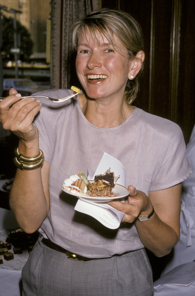 Martha Stewart eating cake during a National Pastry Competition event in 1990
