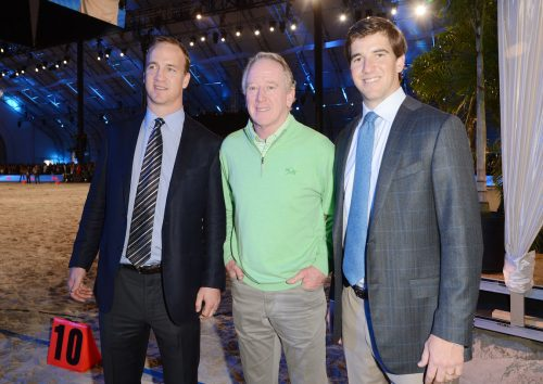 Peyton, Archie, and Eli Manning at DirecTV's Seventh Annual Celebrity Beach Bowl in 2013