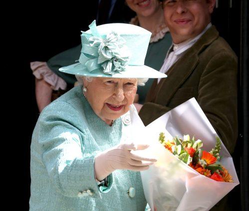 Queen Elizabeth visiting a replica of the original Sainsbury's in London in 2019