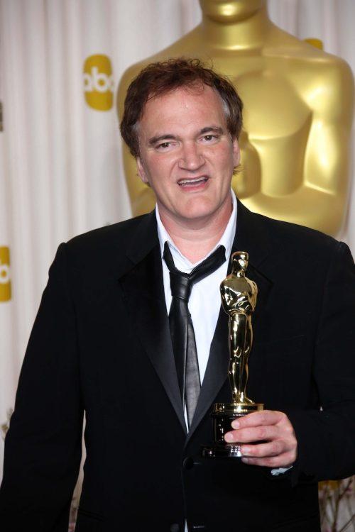 Quentin Tarantino with his Oscar at the 2013 Academy Awards