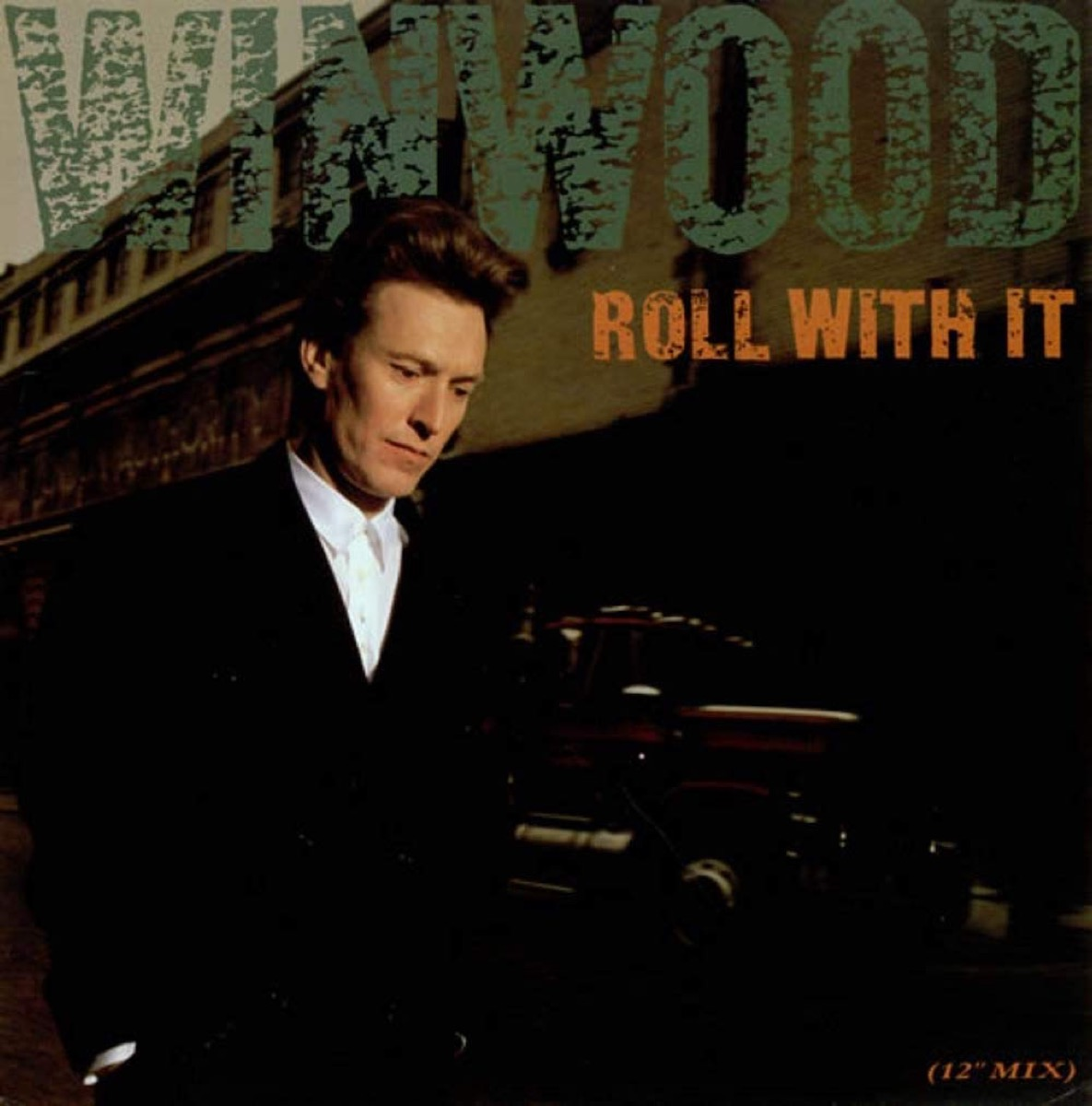 """Steve Winwood """"Roll With It"""" single cover"""