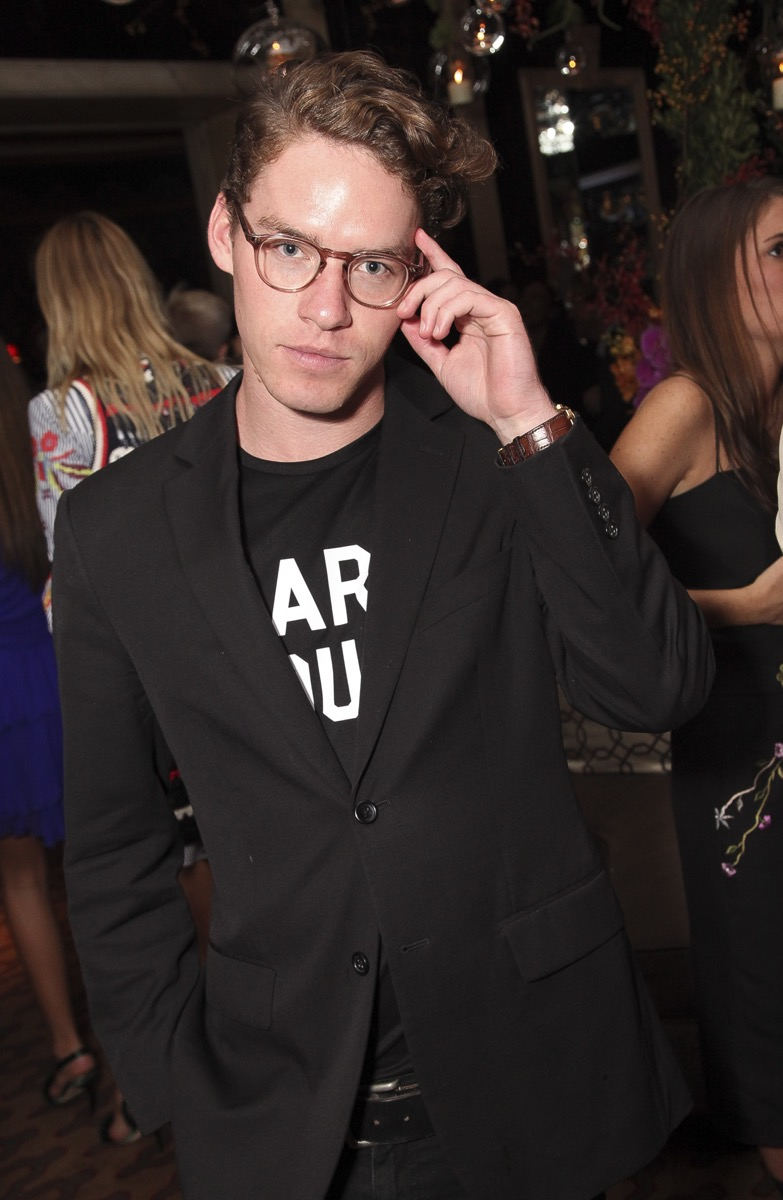 Tyler Clinton wearing glasses and black jacket