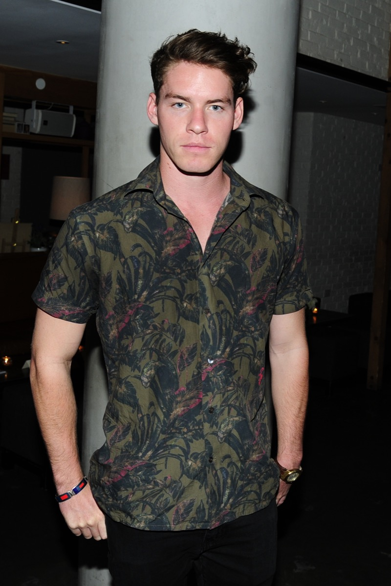 Tyler Clinton in patterned shirt backstage