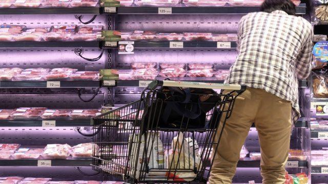 Man shopping for bacon