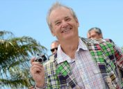 bill murray in green plaid jacket holding tiny camera