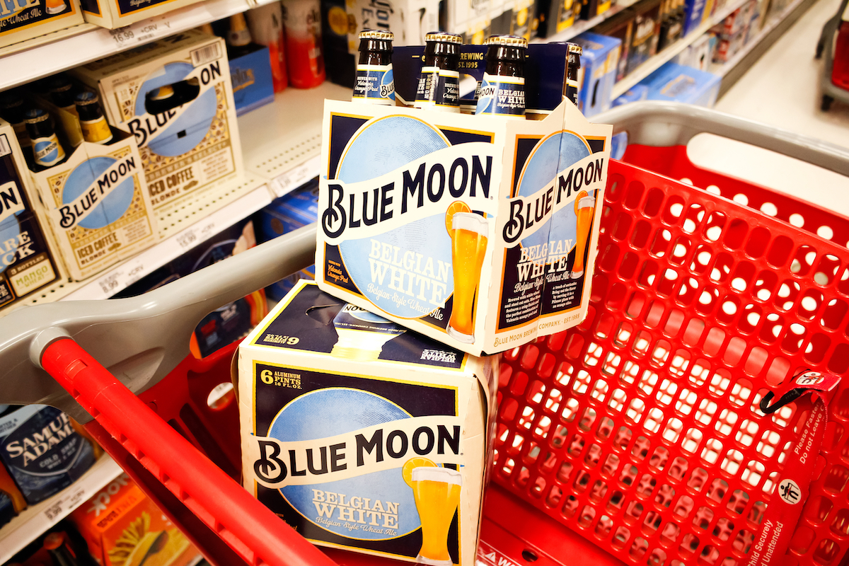 A view of several cases of Blue Moon beer stacks inside a shopping cart, in a local grocery store.