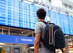 Man looking at plane times