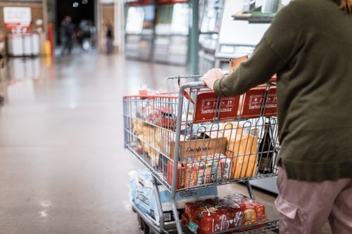 Tigard, Oregon - Nov 8, 2019 : People with carts in Costco Wholesale. Costco is an American multinational corporation which operates a chain of membership only