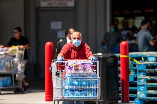 Elderly man stocking up on water due to Covid 19 Coronavirus pandemic crisis Miami FL Costco