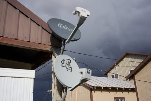Parkdale, Oregon, USA - Oct 26, 2019: DISH satellite TV antennas are seen in a farm. DISH Network Corporation is a U.S. television provider.
