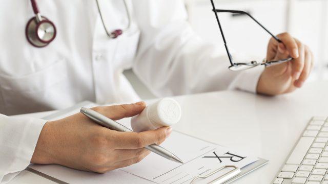 Woman,Doctor,Writing,Prescription