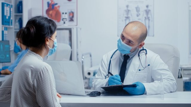 Doctor and patient wearing masks