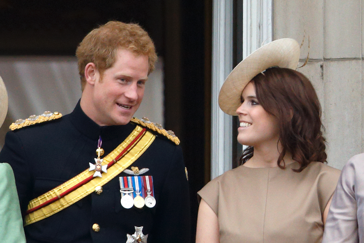 Prince Harry and Princess Eugenie stand on the balcony of Buckingham Palace during Trooping the Colour on June 13, 2015 in London, England.