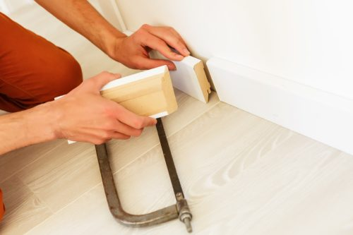 Installing the new skirting board after changing the parquet