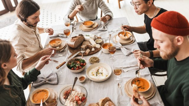 group of 20- or 30-something friends eating soup at lunch at large table