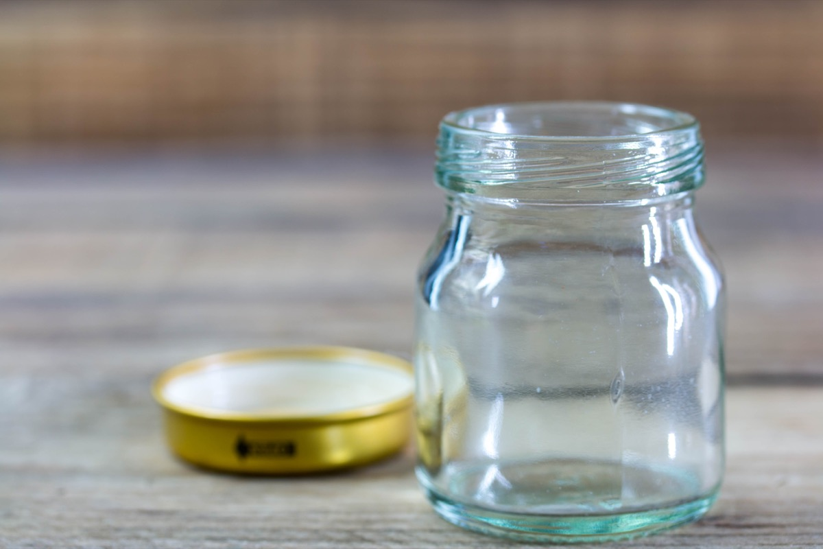 open glass jar next to gold lid
