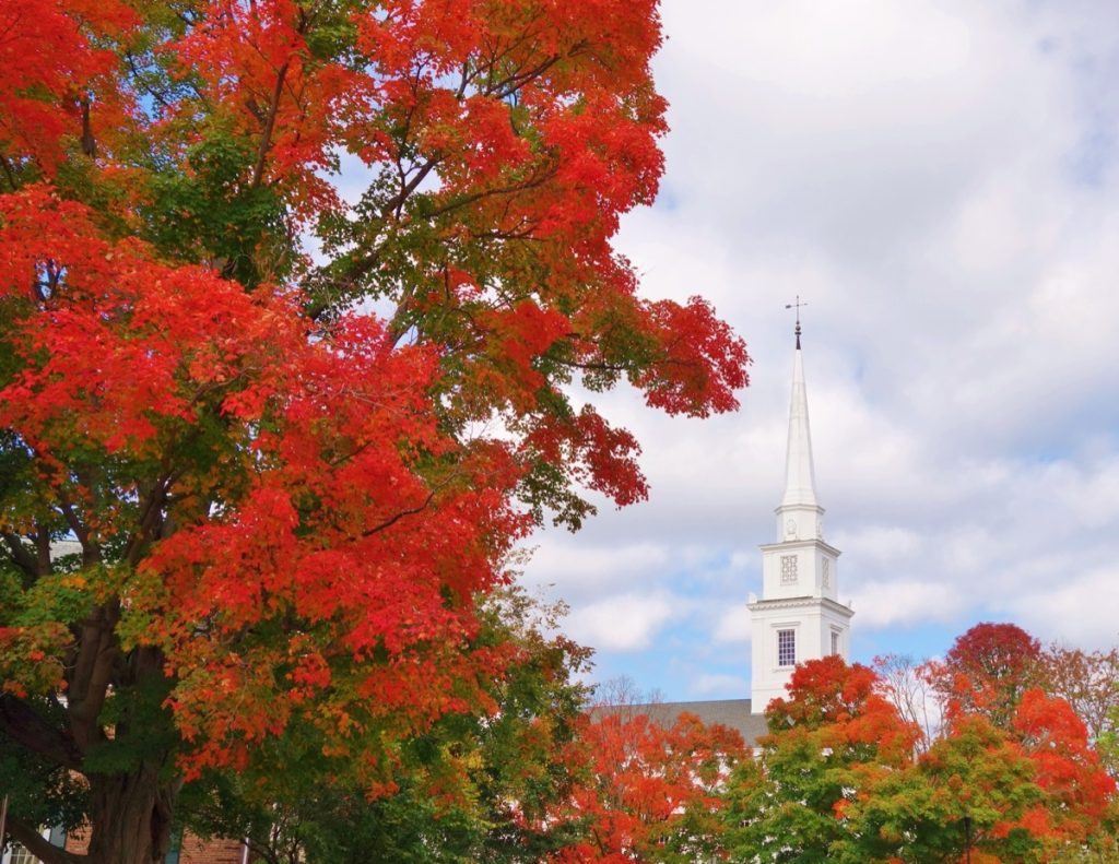 Red trees and a church in Hanover, New Hampshire
