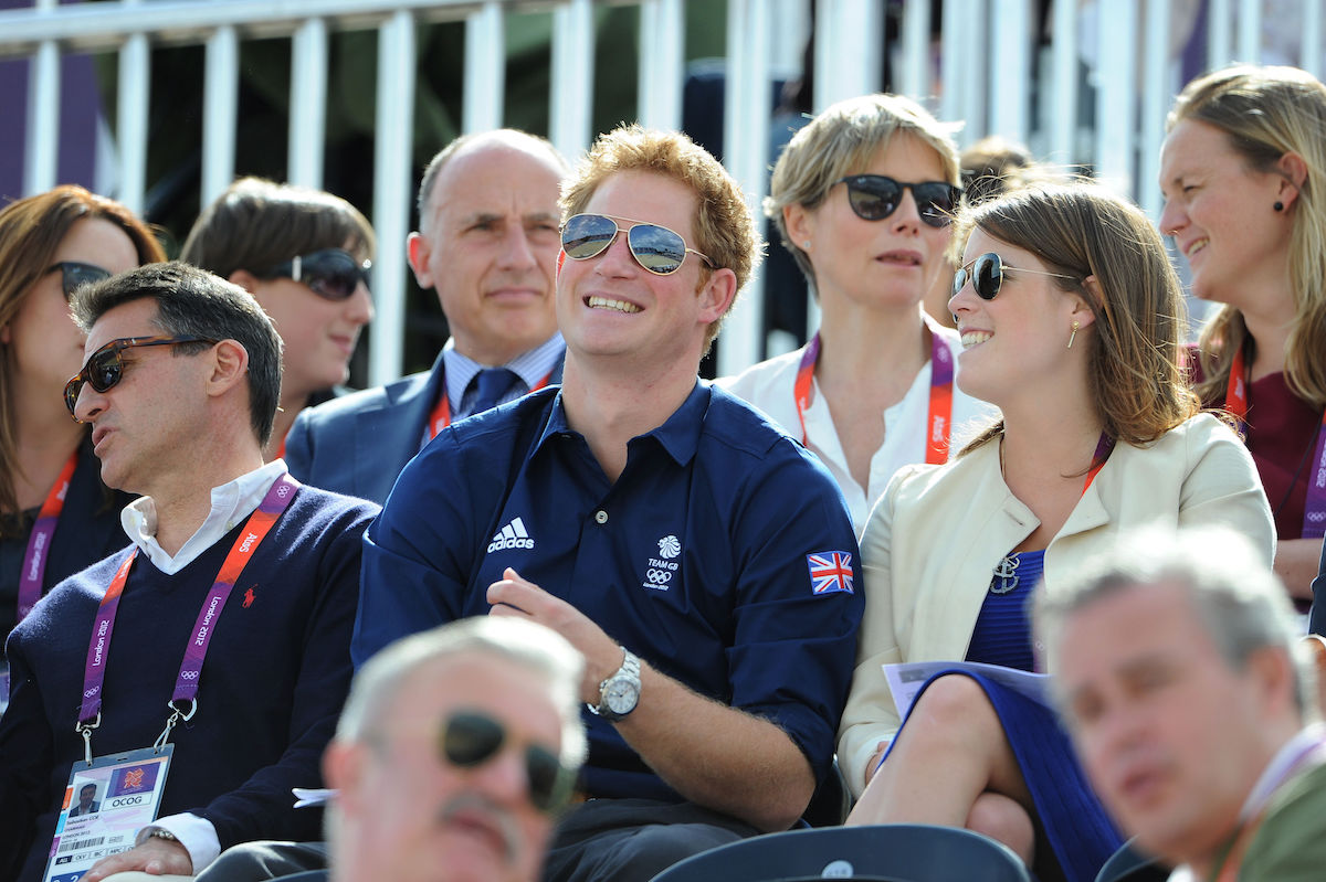 Prince Harry and Princess Eugenie as they watch the Cross Country Phase of The Eventing at Greenwich Park, on the third day of the London 2012 Olympics.