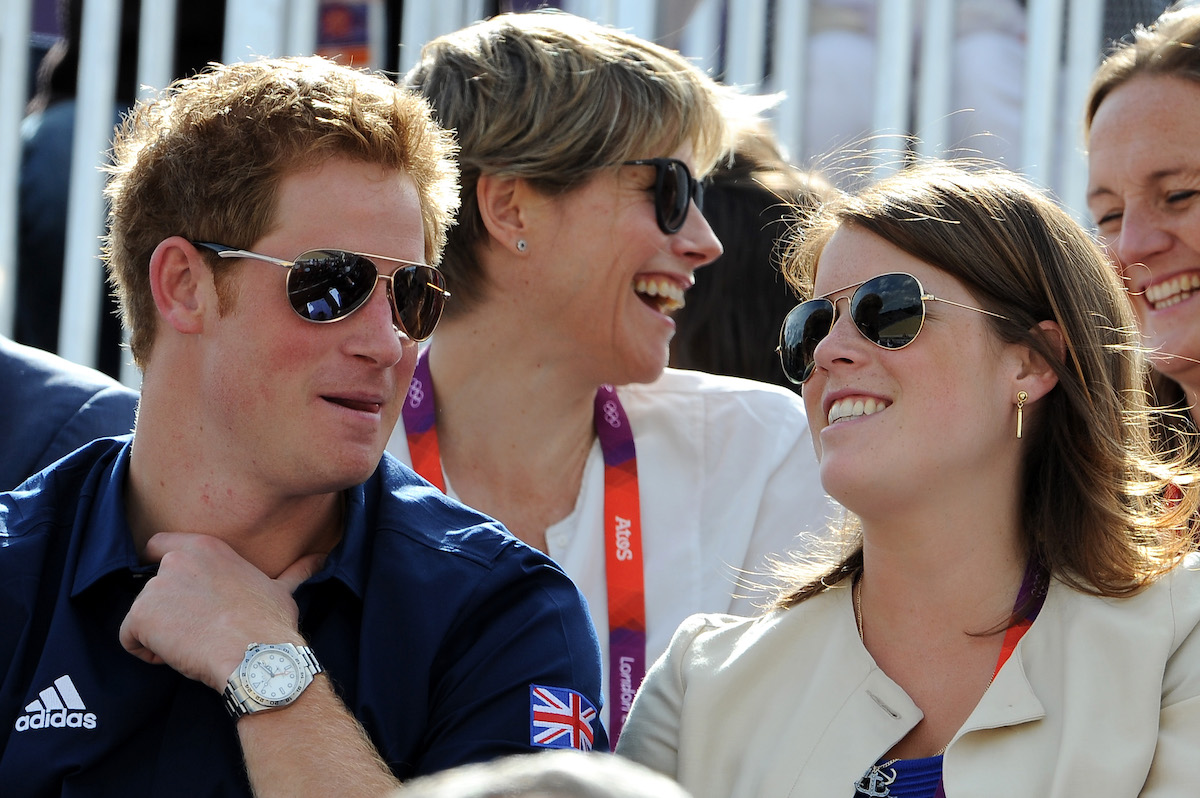 Prince Harry, and Princess Eugenie watch the Eventing Cross Country Equestrian event on Day 3 of the London 2012 Olympic Games at Greenwich Park on July 30, 2012 in London, England.