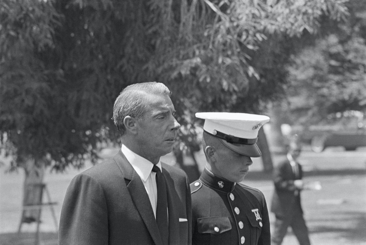 Joe DiMaggio (accompanied by son Joe DiMaggio Jr., in marine uniform) at Marilyn Monroe's funeral.
