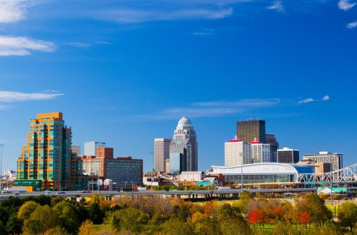 Louisville downtown skyline view with a park with trees in the foreground. Picture taken during autumn.