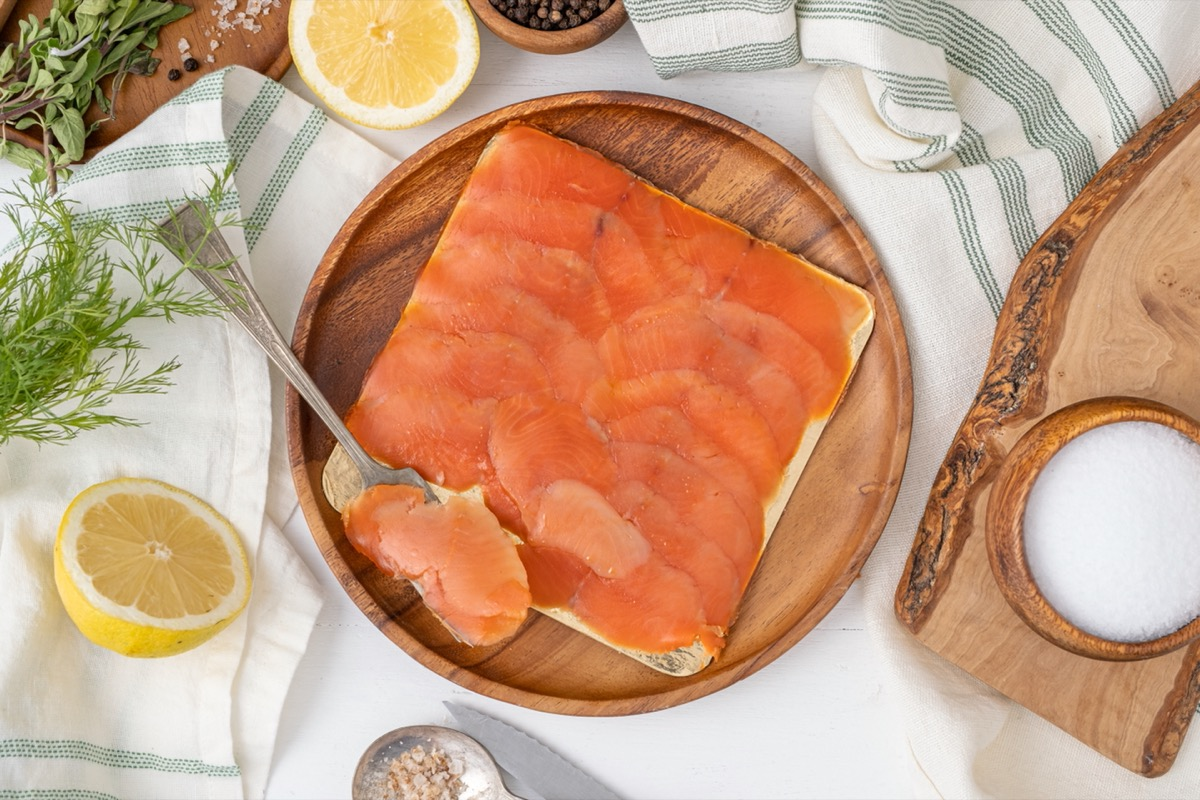 wooden plate with lox on it
