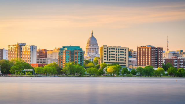 The skyline of Madison, Wisconsin from the lake at dusk