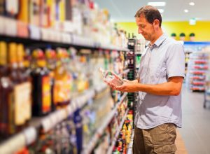 Man buying liquor at the supermarket