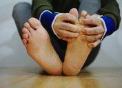 A close up of a man checking his feet