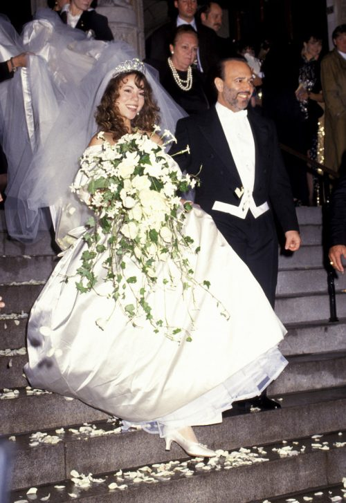 Mariah Carey and Tommy Mottola at their wedding in 1993