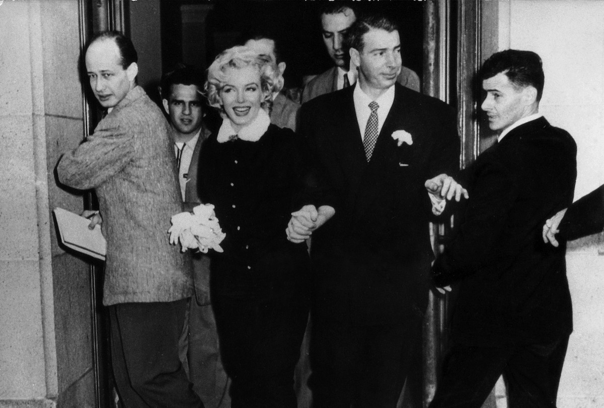 The American actress Marilyn Monroe and her husband Joe DiMaggio leaving the town hall after their wedding. San Francisco, 14th January 1954