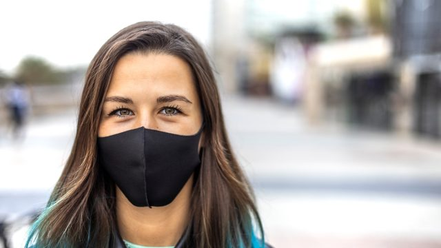 Woman wearing a mask outdoors