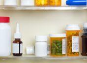 medicine cabinet full of prescription bottles and jars