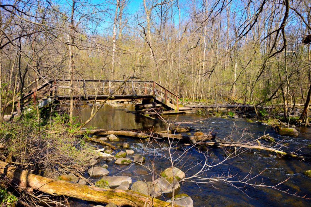 a wooden bridge goes over a river near Merton, Wisconsin