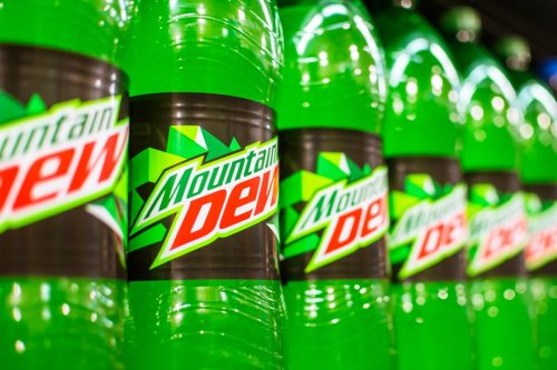 Manila, Philippines - July 2020: A row of Mountain Dew 1.5 Liter soda on display at an aisle in a supermarket.