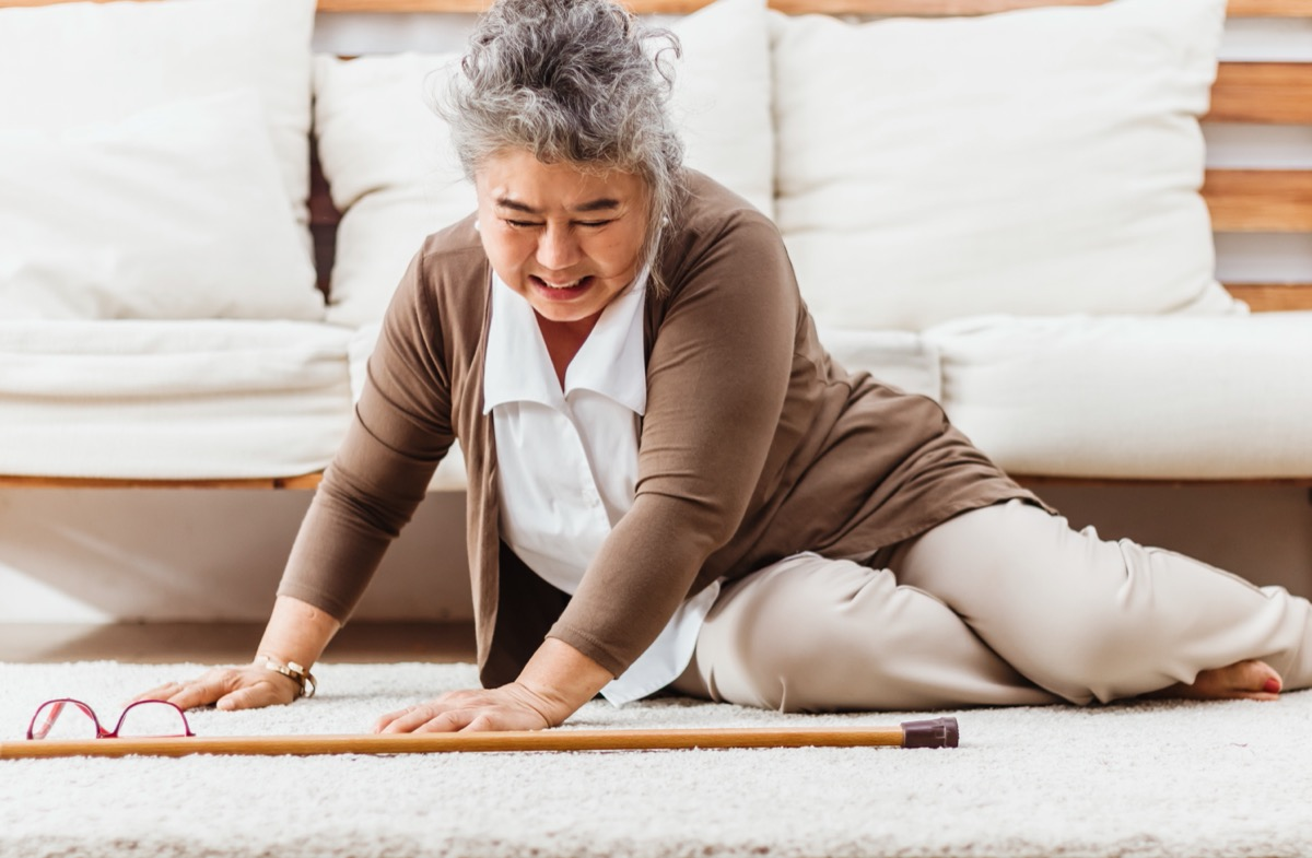 older woman who fell in front of sofa at home