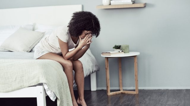 woman with widespread pain on bed