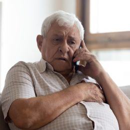 Man stressed on phone call
