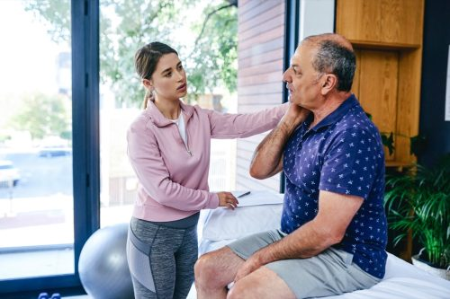 Shot of a senior man visiting a physiotherapist for a consultation