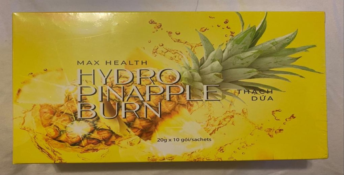 yellow box of max health hydro pineapple supplements with pineapple image on box