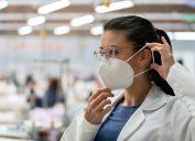female virus expert putting on masks
